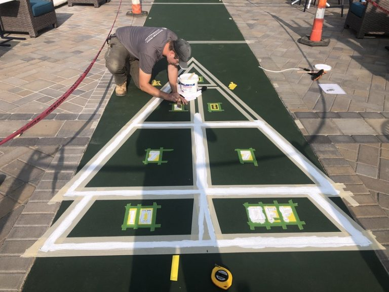 Painting the Numbers on the Shuffle Board Court